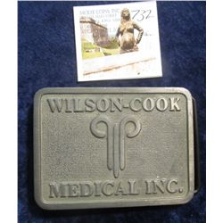 732.  Odd belt buckle – Wilson-Cook Medical Inc.