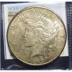 865. 1923 S Peace Silver Dollar. Fully toned AU.