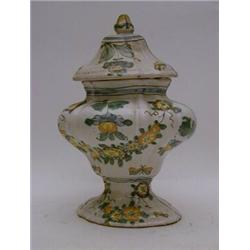 A Tin Glazed Earthenware Urn And Cover Of Bombe Form Polychrome