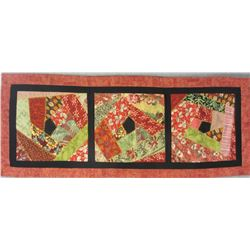 Susan M. Foster Table Runner – Crazy quilted Table Runner.  It is machine embroidered with stitch-in