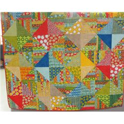 "70"" x 70"" Wild and wonderful layer cake quilt from the fabric collection of Malka Dubrawsky.  It is"