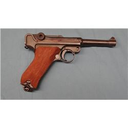 "Luger 9mm, semi auto, 4"" barrel, s#7336. reworked and import marked."