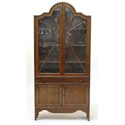 Oak Bookcase, The Dome Shaped Top Above A Pair Of Glazed Doors Enclosing  Three Adjustable Shelvesu2026
