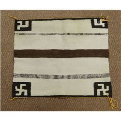 Navajo 1/2 size saddle blanket with a rolling log pattern, 32 inches by 27 inches. In good condition
