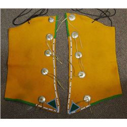 "Sioux fancy dancing beaded felt chaps, 25"" h, decorated with conchos and are beaded.  In good condit"