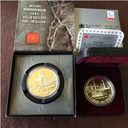 RCM; 1991 Proof dollar in case, 2003 BU dollarr in box. Lot of 2 coins.