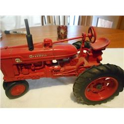 TOY CAST IRON FARMALL TRACTOR W/ RUBBER TIRES