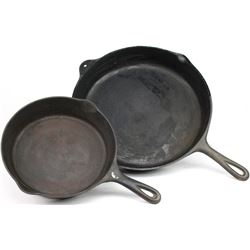 Collection of 2 antique cast iron skillets