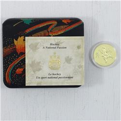 """1991 Canada 22 Karat $200 """"Hockey - A National Passion"""" Gold Coin. This coin weighs 17.13 grams and"""