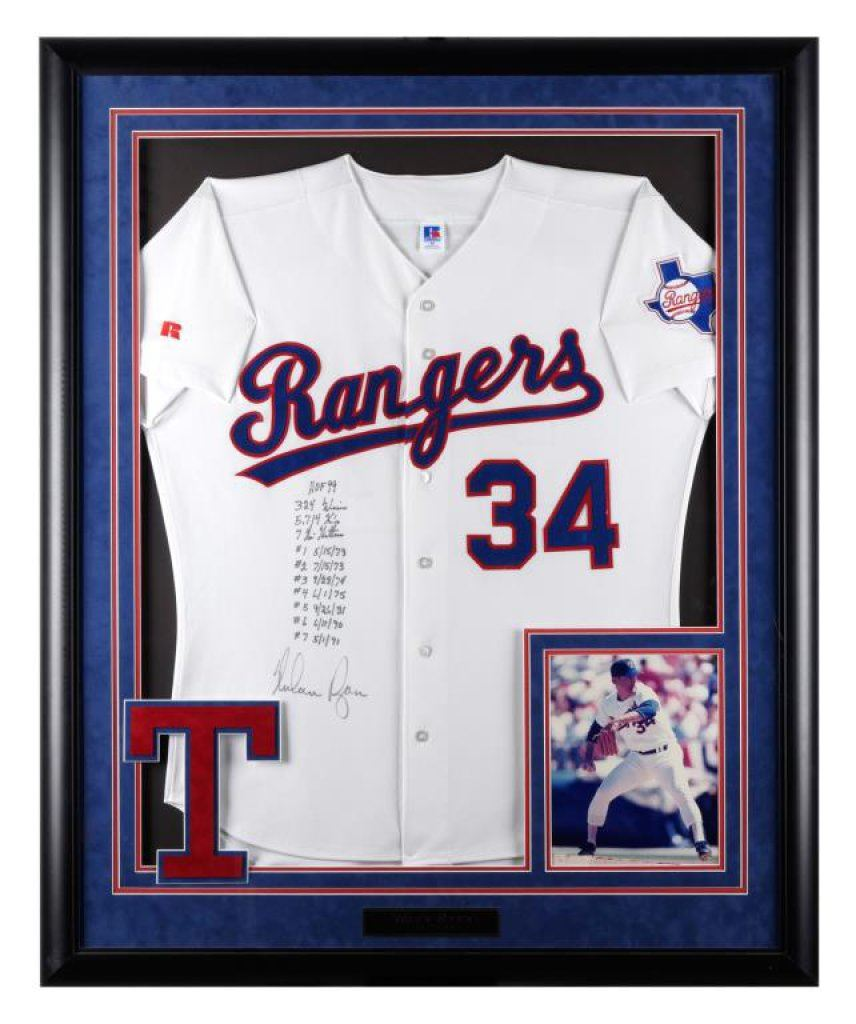 Framed professional baseball jersey #34 of the Texas Rangers, signed ...