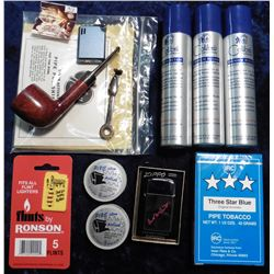 To be sold on the floor only.  A Group of Smoking supplies from the Estate.  Includes Pipe, lighter,