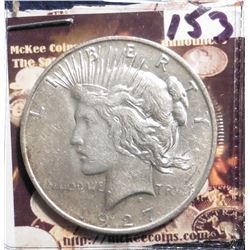 1927 D U.S. Peace Silver Dollar. Almost Uncirculated.