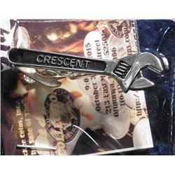 "Tie Pin ""Crescent"" exhibits a Crescent wrench but may have been given out locally by Crescent Electr"