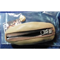 "Zipper Pouch and a Military Collar Pin. ""Ruptured Duck"""