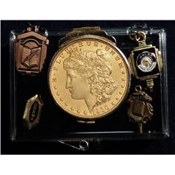 Plastic snap-tight box with a Gold-plated 1900 Morgan Silver Dollar in a piece of jewelry; & (4) Gol