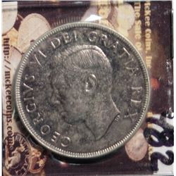 1951 Canada Silver Dollar. Prooflike. Light toning.