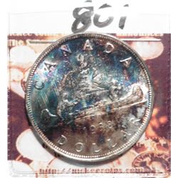 1938 Superb Gem Uncirculated Canada Silver Dollar with rainbow toning. KM37. KM value $250+++.