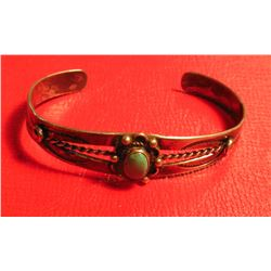 Sterling Silver Zuni style Indian oval Cabochon Turquoise Bracelet.  Not signed. Weighs 0.48 oz. Tro