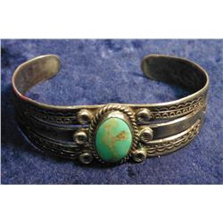 Sterling Silver Zuni style Indian oval Turquoise Cabochon Bracelet. Five insets. Not signed. Weighs