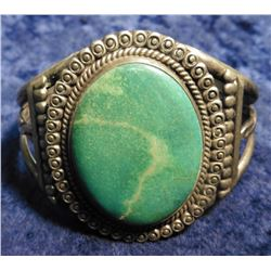 Large Turquoise Cabochon (41 mm x 27 mm) Sterling Silver Bracelet. Unsigned. Weighs 1.95 troy ounces