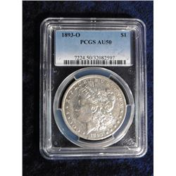 "1893 O Morgan Silver Dollar. Slabbed ""PCGS AU50"", serial number 7224.50/32082597. Red Book value $77"