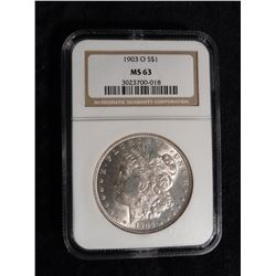 "1903 O Morgan Silver Dollar. NGC slabbed ""MS 63"". Serial number 3023700-018. Red Book value is $440."
