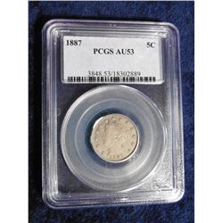 "1887 Liberty Nickel slabbed ""PCGS AU53"". Serial number 3848.53/18302889. Red Book value $110.00."