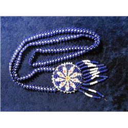Historic Beaded Indian Necklace. Blue, white, yellow, and coral seed beads.