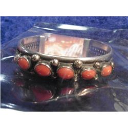 Sterling Silver and Coral Navajo Style Bracelet. Weighs 61.4 grams.