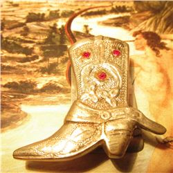 "Western Boot style Money Clip with three red sets. Stamped ""Silver Mexico"". Weighs 1.285 ounces."