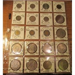 "(20) World Coins in 2"" x 2"" holders and plastic page from  Luxembourg, Macau, & Mexico. Total Krause"