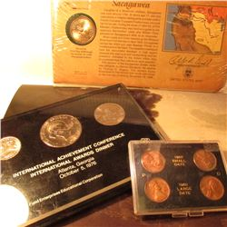 Four Piece Set of 1960 P & D Small and large date Lincoln Cents in a holder; 2000 P Sacagawea Dollar