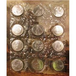 1867-1992 Twelve Provinces Canada Quarter Set in original cellophane. Gem BU.