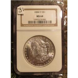 1884 O Morgan Silver Dollar. NGC slabbed MS64. Beautiful reverse toning.