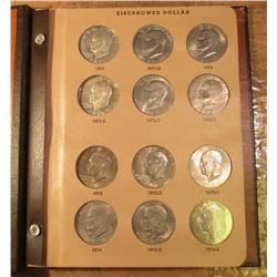 1971-78 Partial Set of Eisenhower Dollars in a World Coin Library Album. Includes some Silver and so