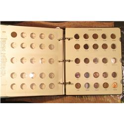 Like new Littleton Coin Company Album with 1910-57 partial set of Lincoln Cents. Many nice BU.