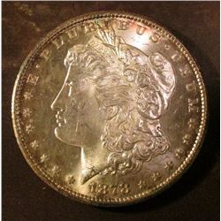 1878 S Morgan Silver Dollar. Brilliant Uncirculated with light gold toning.