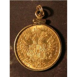 1915 Austrian Gold Ducats. Contain 0.1106 troy ounces of gold. Mounted in a bezel to be suspended on