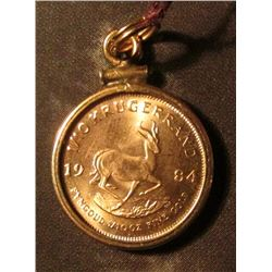1984 South African 1/10 ounce Gold Krugerrand in a bezel to be suspended on your necklace. AU-BU.