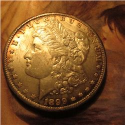 1899 O Morgan Dollar lightly toned Uncirculated.