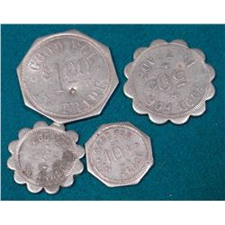 """Wyatt Johnson/Dept./Store/Eldora,/Iowa."" 4 pcs. Set of Good For Tokens. 10c, 25c, 50c, & $1.00."