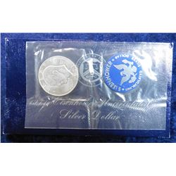 1971 S BU Eisenhower Silver Dollar in an original blue envelope of issue.