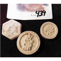 Three different Siamese Porcelain Gambling Tokens. All with high relief figures on one side and blue