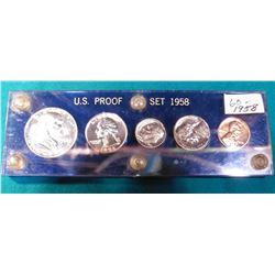 1958 U.S. Proof Set in a royal blue Capital holder with gold lettering.