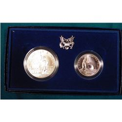 1886-1986 Statue of Liberty BU Silver Dollar and clad Half-Dollar. In original U.S. Mint box as issu