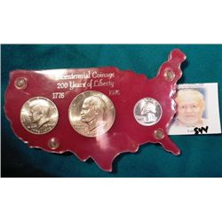 1776-1976 S 40% Silver Three-Piece Mint Set in a red Capital holder with gold lettering. Includes Si