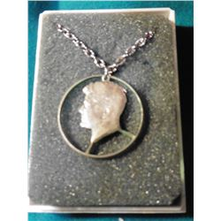 Silver Kennedy Half-Dollar Cut-out Coin on Necklace and in jewelry case. Originally priced years ago