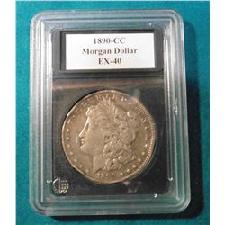1890 CC Morgan Silver Dollar with a few rim bruises in a plastic case. Guaranteed Authentic mintage