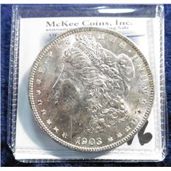 1903 O U.S. Morgan Silver Dollar. Superb Brilliant Uncirculated. Lovely golden toning. Super Key dat