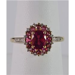PINK TOURMALINE & DIAMOND RING OVAL PRONG SET PINK TOURMALINE SURROUNDED BY 12